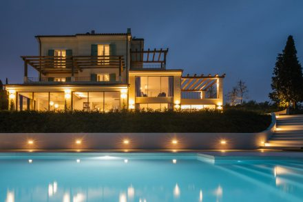 villa and pool at night